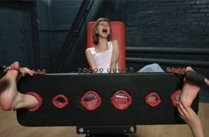 Fashion model gets tickled in stocks by four hands