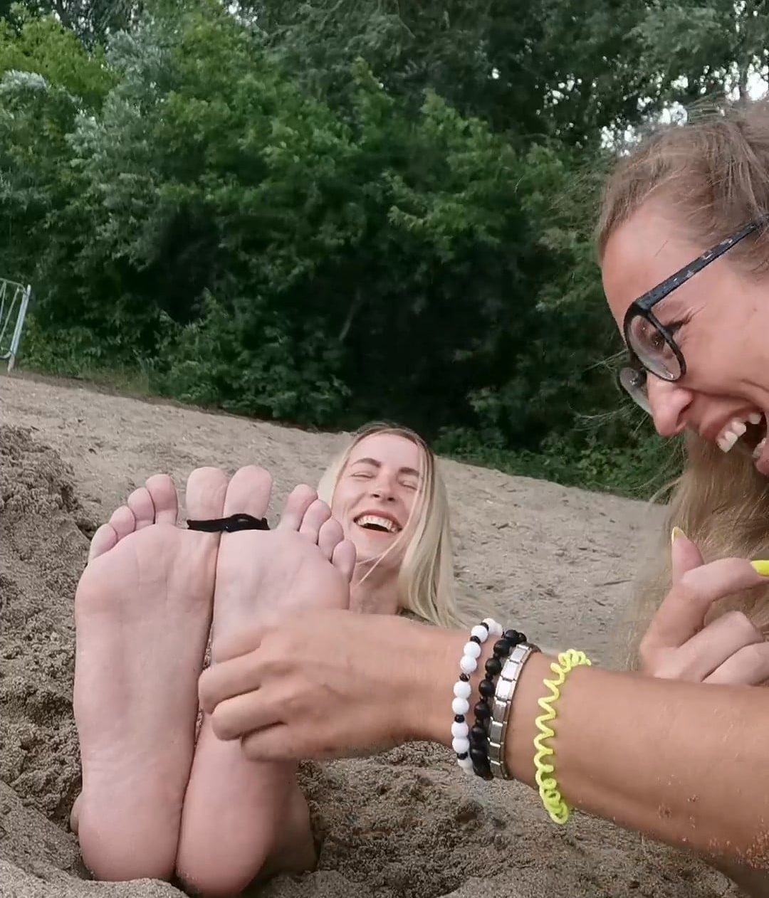 Vera tickles Natasha, Buried in the Sand, In public